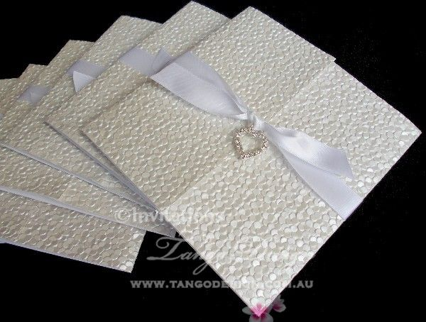 Tiffany white invites: Embossed Wedding Invitations by www.tangodesign.com.au with crystal heart pendant #blingheartinvitations #heartinvitations #embossedweddinginvitations #handmadeweddingcards