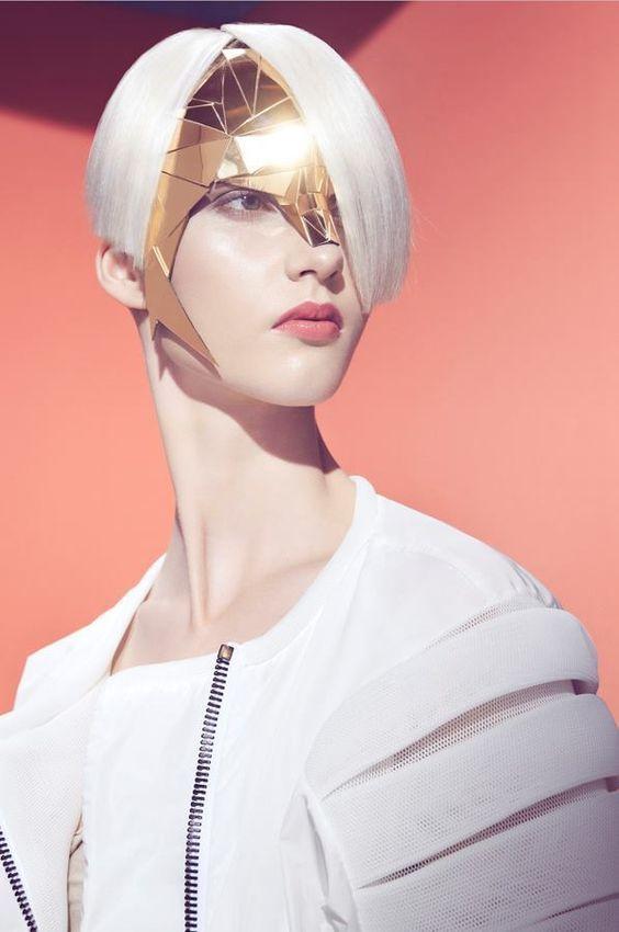 Futuristic accessories in this geometrical-inspired session are by Halina Mrozek.  Photography Łukasz Brześkiewicz.