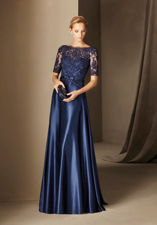 The lace and tulle of this bateau-neckline maid of honor dress play with the sheerness that ends at the waist. The satin provides volume to the design, and the gemstones throughout the bodice make it shine. The Knot provides price estimates to give you a general idea of the cost of a dress. Please visit retailers in your area for exact pricing. Prices will vary by region.