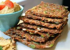 Raw Carrot Sandwich Bread (OR CRACKERS) 1 c. ground flaxseed 1/2 c. whole flaxseed 2 c. carrot pulp (carrot/apple pulp makes the bread sweeter) 1/2 c. pumpKin seeds 1/2 c. sunflower seeds 1 tsp. sea salt 1 1/2 c. water