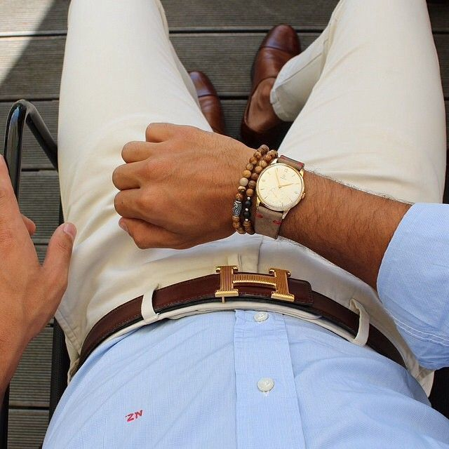 Try pairing a baby blue oxford shirt with beige chinos to achieve a dressy but not too dressy look. Add brown leather double monks to your look for an instant style upgrade.   Shop this look on Lookastic: https://lookastic.com/men/looks/dress-shirt-chinos-double-monks-belt-watch-bracelet/13080   — Brown Leather Double Monks  — Beige Chinos  — Brown Bracelet  — Brown Leather Watch  — Dark Brown Leather Belt  — Light Blue Dress Shirt