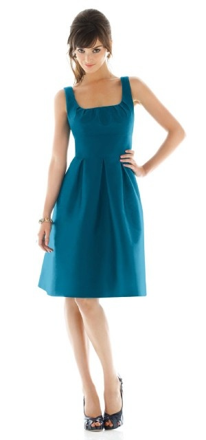 A cute and flattering bridesmaid dress. In green it would be pretty!