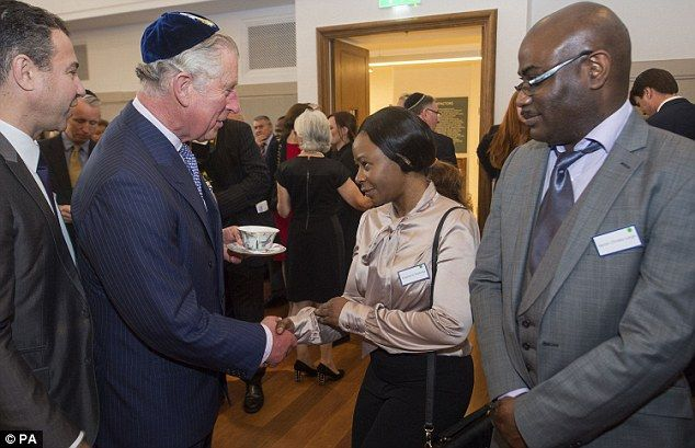 The Prince of Wales meets Roselyne Kwanga (second right), a refugee from Sierra Leone, as he marks the anniversary