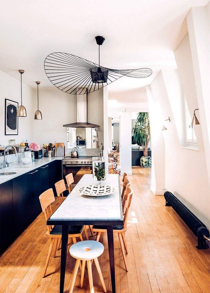 Lighting, table and opening to the living room , all stylish