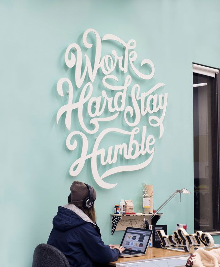 Clarke Harris: Work Hard Stay Humble via Design Work Life | Love the hand lettered wall installation!
