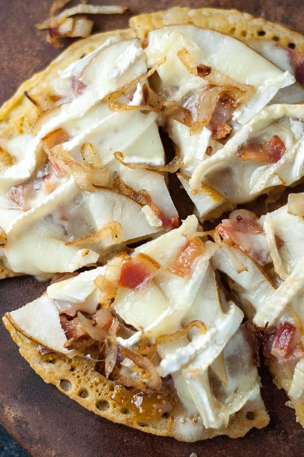 A gluten free gourmet pizza dream come true! Pear, Brie, Caramelized Onion, Bacon Socca Pizza with Fig Jam is sweet, creamy, and savory recipe all wrapped up in one meal! Gluten free as well as gluten full noshers will all be happy with this recipe! http://www.mamagourmand.com