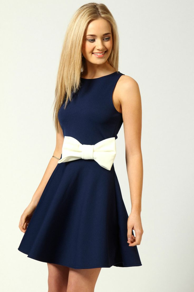 A sleeveless navy fit and flare mini with a great big fabulous white bow at the waist. Super fun if you're young :). Style Planet