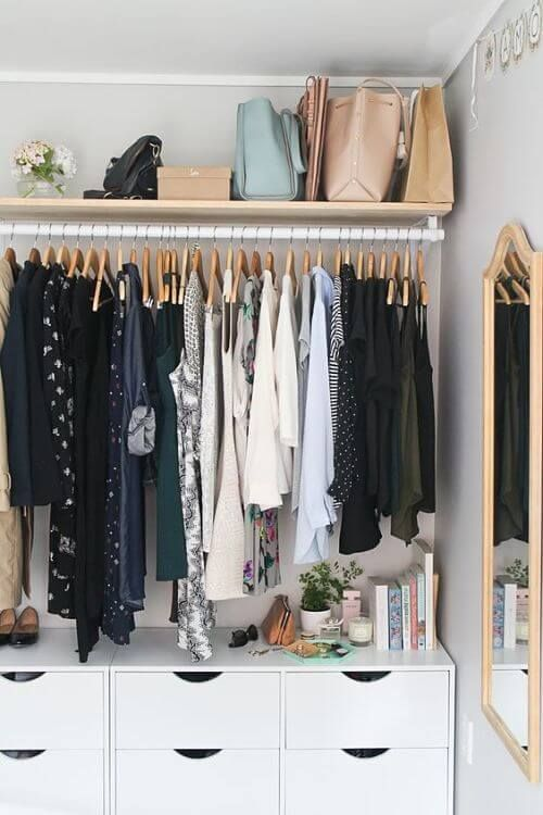 Keep as much as possible folded in drawers. Bags within bags is another way to store purses! A mirror in the closet is a nice touch and goes in the direction of making the closet feel like a tiny room!