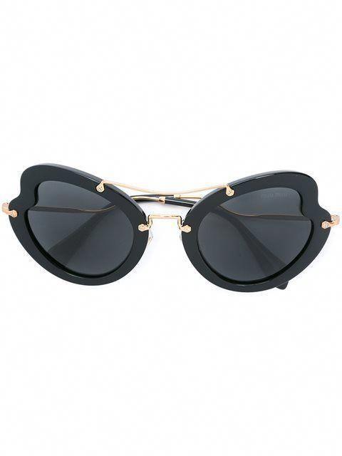 9d3f9624efde4d Shop Miu Miu Eyewear oversized tinted sunglasses.  MiuMiu