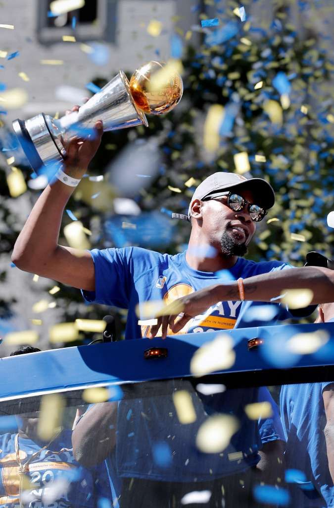 Kevin Durant holds the MVP trophy  during the Golden State Warriors NBA championship victory parade through downtown Oakland, Ca., on Thursday June 15, 2017. Photo: Michael Macor, The Chronicle