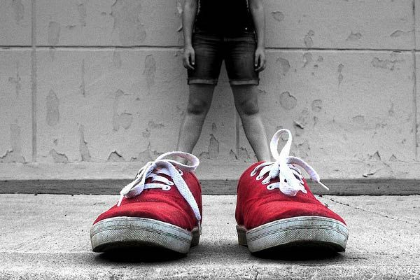 Forced perspective- gives the image a story and creates a comical view on perspective. The shoes are not in proportion to the man standing there.