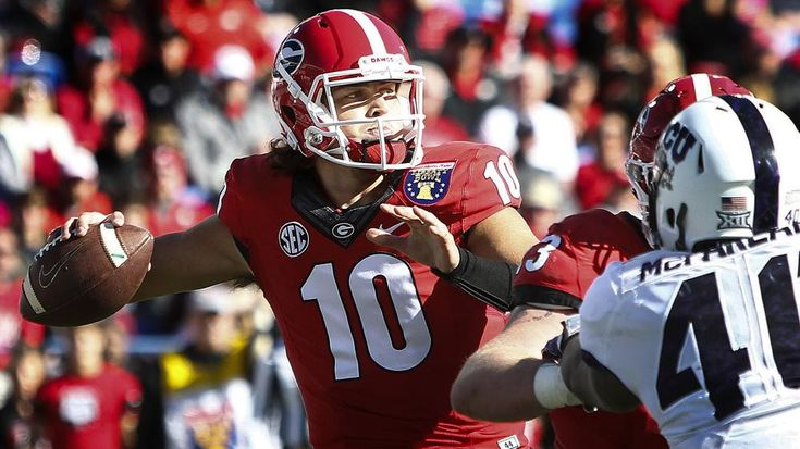 Mark Weber/AP Georgia quarterback Jacob Eason makes a throw against TCU during the first quarter of the Liberty Bowl Friday, Dec. 30, 2016, in Memphis, Tenn. Georgia' freshman quarterback completed 12 of 21 passes for 164 yards and 2 touchdowns. Courtesy AJC