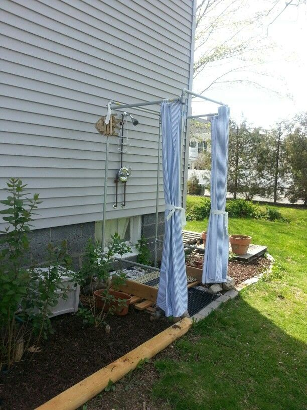 DIY - Outdoor shower stall with galvanized pipes and duck shower curtains