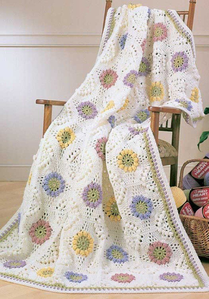 Crochet Floral Bouquet Afghan in Red Heart Super Saver Economy Solids - LW1575. Discover more Patterns by Red Heart Yarns at LoveKnitting. The world's largest range of knitting supplies - we stock patterns, yarn, needles and books from all of your favorite brands.