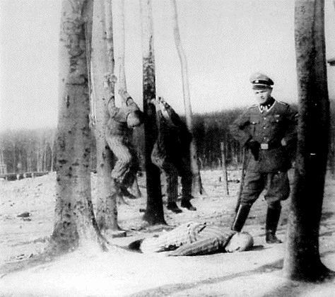A picture of Kurt Franz posing jauntily as he administers punishment at Buchenwald.
