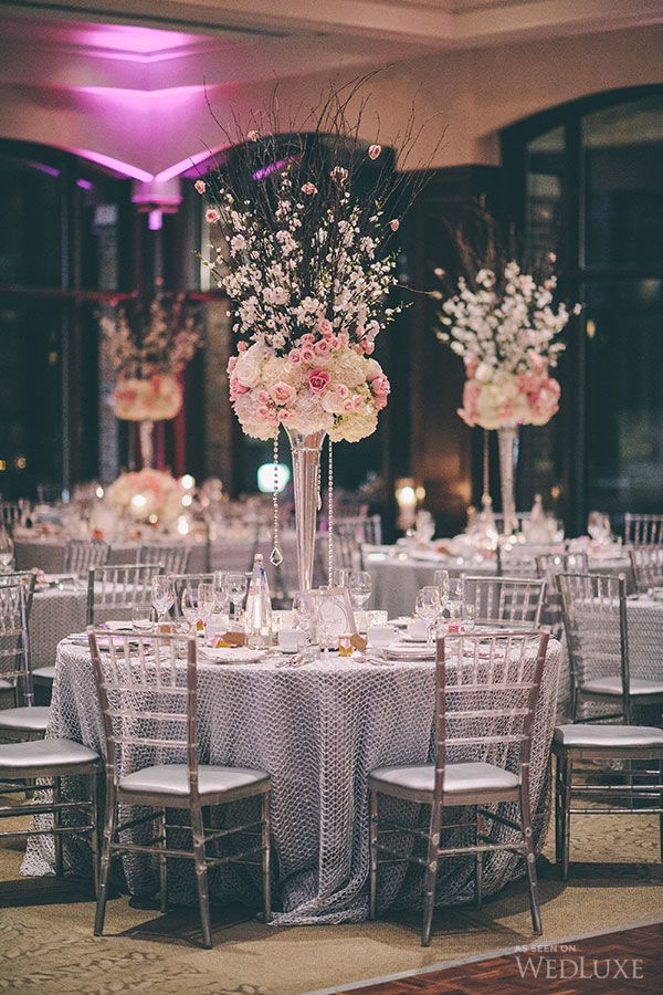 Pink and cream tall vase centrepiece with tall blossom branches - WedLuxe – Rania + Kia | Photography by: Lifeimages. Follow @WedLuxe for more wedding inspiration!