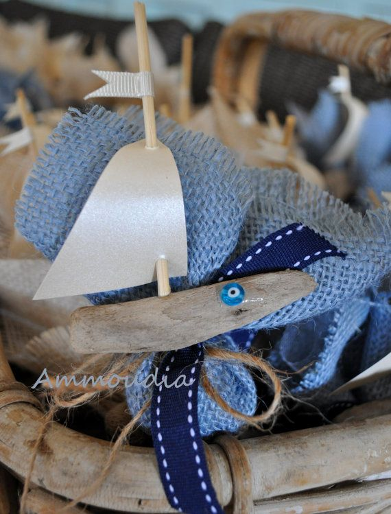 A cute little driftwood boat favor. Decorated with blue ribbons and blue evil eye glass bead. Baby shower favor or wedding favor. Decorate the table or put them on your guests plate as a little favor/bomboniere. This listing is for one favor/bomboniere that includes: 1. light blue burlap filled with 5 greek almond candies/koufeta Chatzigiannaki 2. one driftwood boat with pearlized ivory cardstock sail decorated with blue evil eye  If you would like me to decorate the boat with ...