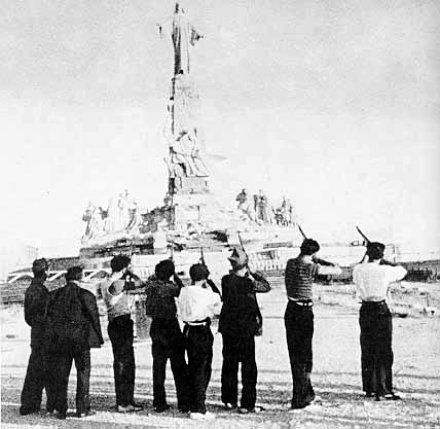 Execution of the Sacred Heart of Jesus by Communist militiamen at Cerro  de los Ángeles near Madrid, on 7 August 1936. This was the most famous of  the widespread desecration of images and Churches