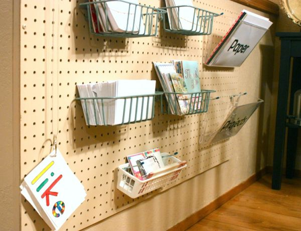 Attach baskets to pegboard for accessible paper storage.