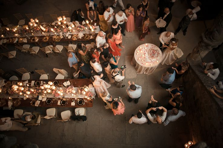 A landscape picture of the dinner area and the preparation of the wedding cake