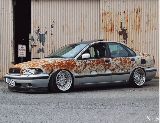 Rat rod style S40. (Camo paint blends with background).