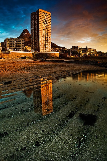 Reflected Gold    Dramatic sunset over a Sea Point building in Cape Town, South Africa.