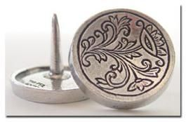 Pewter Cheese Buttons  SKU: F1710    Cheese Buttons, made of pewter from Norway, give your fingers a place to grip a block of cheese when slicing. Decorated with a traditional rosemaling design.