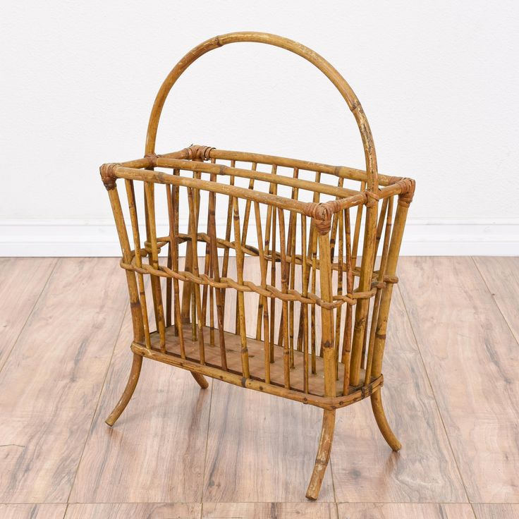 This tropical magazine rack is featured in a rattan and bamboo with a raw finish. This retro rack is in good condition with a curved handle, thin slat rails and 2 interior slots. Beach chic storage piece perfect for books and magazines! #tropical #storage #magazinerack #sandiegovintage #vintagefurniture