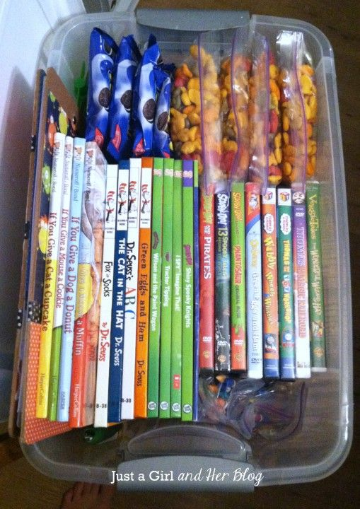 Tips for Traveling with Toddlers- love the box in the middle of the kids with all of the snacks/movies/coloring books.