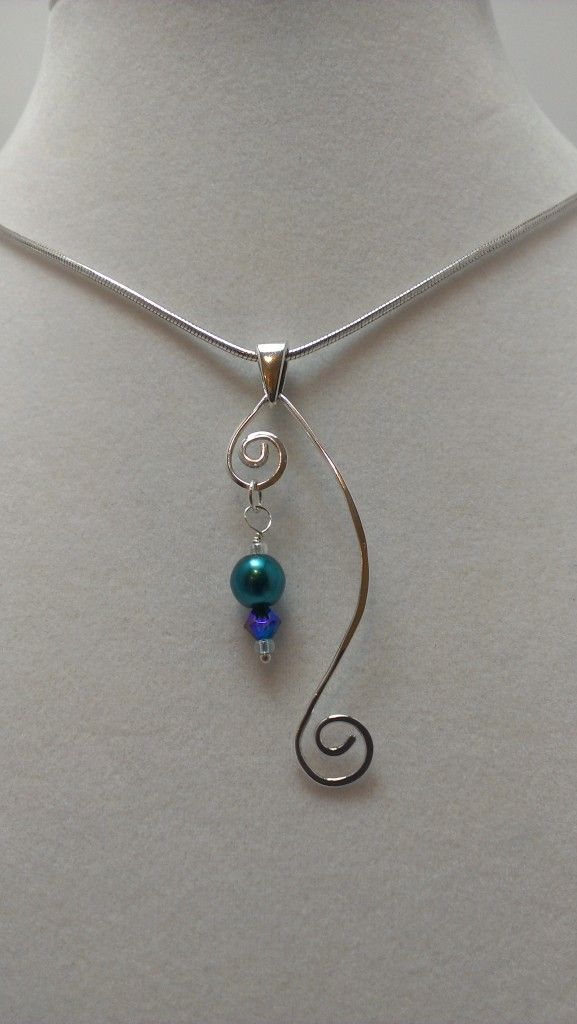 5mm crystal pearl and 3mm crystal bicone dangle on a hand formed fine silver wire pendant ~ made by Arrion Wright   . . . .   ღTrish W ~ http://www.pinterest.com/trishw/  . . . .  #handmade #jewelry
