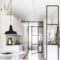 white kitchen, clean lines, minimalist Scandinavian accents, large black glass doors