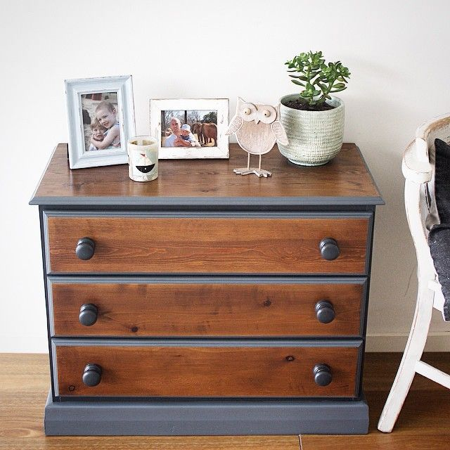 This striking little chest of drawers is made of solid pine. The body has been painted in two tones, Annie Sloane Graphite Chalk Paint and a dark grey, and finished with a satin varnish making it very durable. The top and drawers have been stained walnut and finished with a satin varnish.