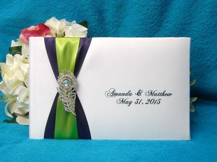 Personalized Peacock guest book with your choice of ribbon and 2 lines of print a perfect touch to your event.