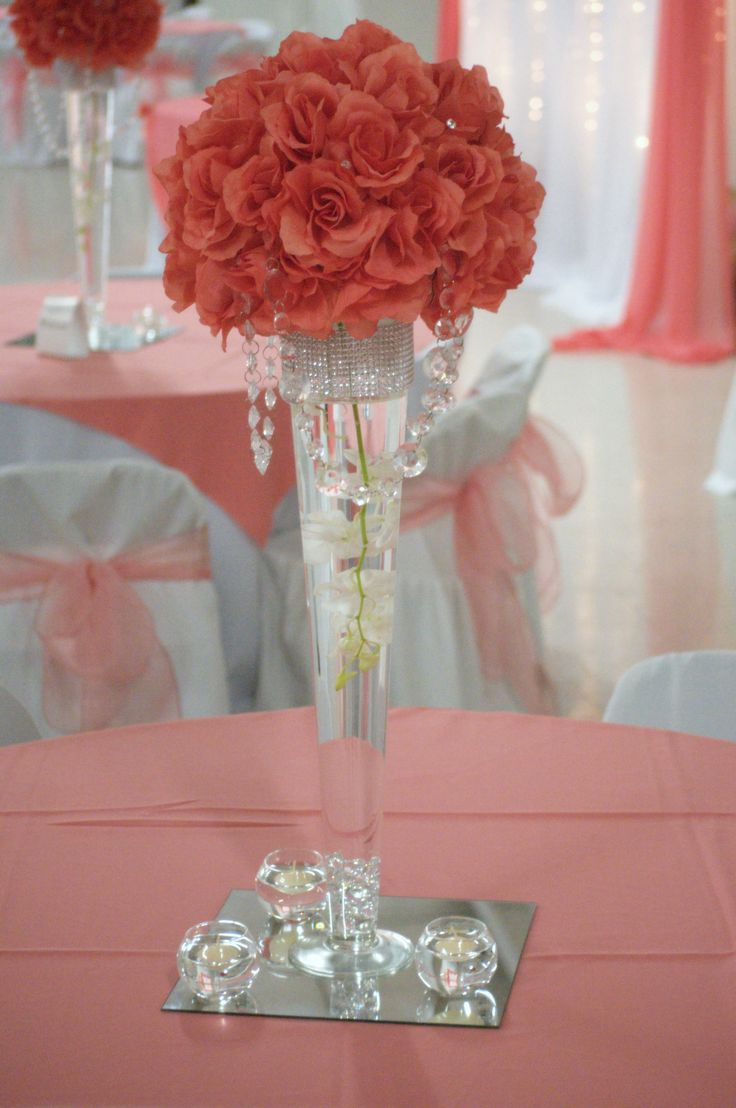 wedding centerpieces, coral wedding but with silver branchs coming out of the top of the flowers!!! :D