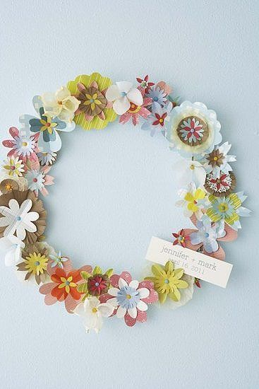 Upcycle old greeting cards and wrapping paper by turning them into a Paper Flower Wreath with instructions from Hello! Lucky.