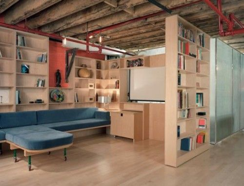 Good idea -- use floor to celing bookcases to create partitions  in semi-finished basement.
