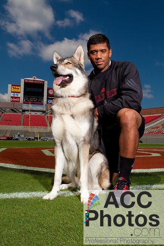 """2010: NC State quarterback, Russell Wilson,  with mascot """"Tuffy"""""""