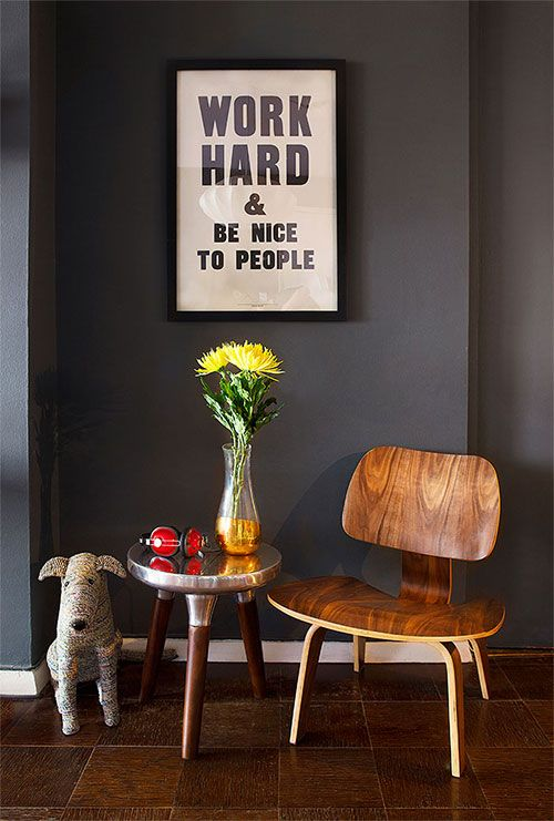 "Sneak Peek: Jessica Walsh. ""This is the entry wall when you first walk into the apartment. The print ""Work hard & Be Nice to People"" is by Anthony Burill. My mom gave me Rover the recycled dog as a gift. My friend Michael Friemuth had an Eames plywood chair in his apartment which I coveted for a while, and finally bought."" #sneakpeek"