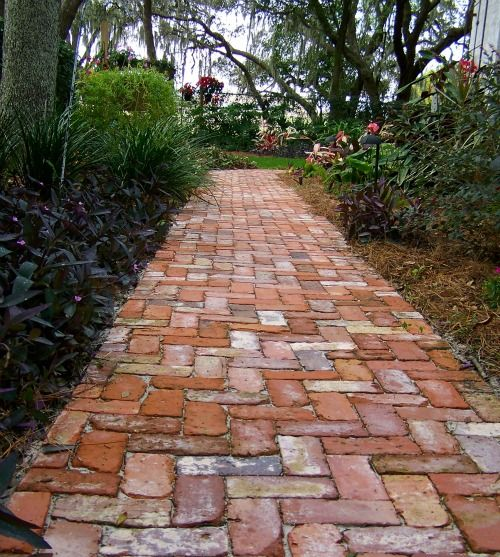 "Reclaimed Brick Path   Goose,"" left, is among the many old statues Peter and Betty ..."