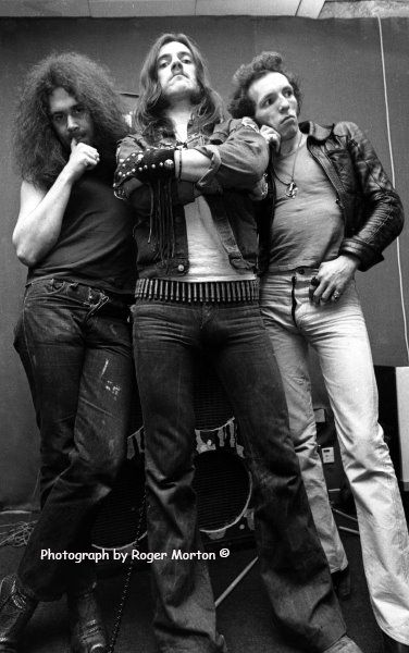 Motorhead, Lemmy Kilmister (Vocals, Bass), Larry Wallis (Guitars) and Lucas Fox (Drums) by Roger Morton.