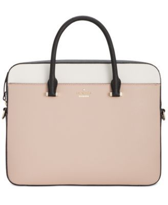 """Take your tech to stylish new heights with kate spade new york's ultra-sleek, ultra-chic Saffiano leather laptop bag. 