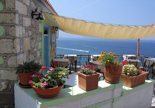 One of the things that you can't miss there is to try the local cuisine, accompanied with refreshing ouzo.
