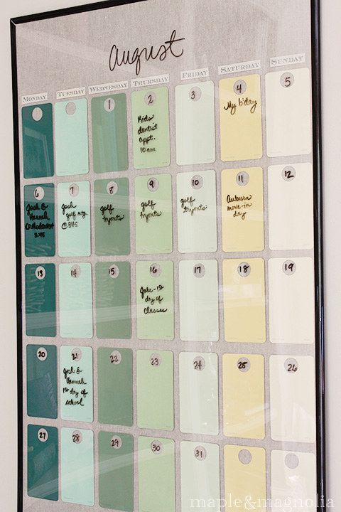 Hot glue paint chips to the inside of a poster frame for a dry erase calendar that actually matches your kitchen towels.