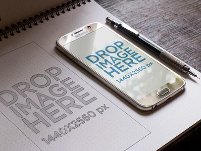 Samsung Galaxy S6 Mockup Lying on Top of a Wireframe Notebook 7056