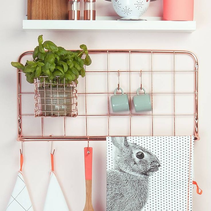 Copper Kitchen Hook Rack This quirky kitchen copper hook rack is great for storing all your kitchen essentials.  It includes a copper wire basket great for storing a herb plant.  It includes 5 individual hooks ideal for hanging utensils, mugs or tea towels.  These also make great gifts for family and friends.  Copper plated<ul> <li>60x30x5cm</li> </ul>