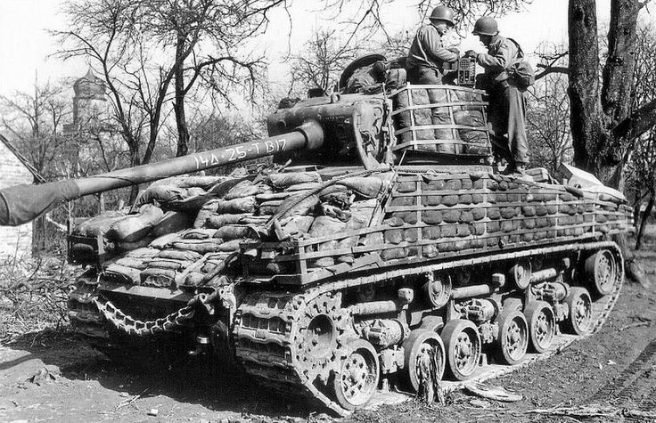 M4A3 (76) W HVSS of 'B' Company, 25th Tank Battalion, 14th US Armored Division, Ohlungen, France, 24 March 1945. Showing the sandbag armour typical of this Division.