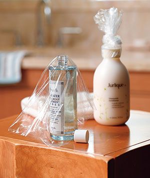 Plastic Wrap Spill Preventor - Stop leaky toiletries from putting a damper on your next vacation by covering each bottle and tube with a layer of wrap.