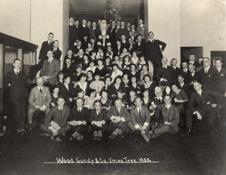 Interior photo of Wood Gundy around the company Christmas tree in 1922. They were located near King and Bay.