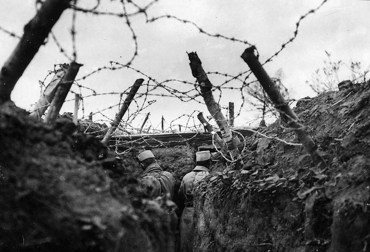 French lookouts posted in a barbed-wire-covered trench. The use of barbed wire in warfare was recent, having only been used for the first time in limited form during the Spanish-American War. All sides in World War I used extensive networks of barbed wire entanglements to prevent ground troops from moving forward. The effectiveness of the wire drove the development of technologies like the tank, and wire-cutting explosive shells set to detonate the instant they made contact with a wire.