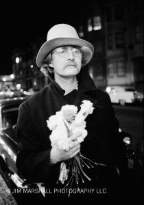 "Richard Brautigan, poet and writer of ""Trout Fishing in America"" with bouquet of carnations and his trademark battered Western hat, caught on the streets of SF in '65 or '66. Photo  by Jim Marshall"